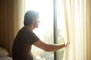 man looking out of a window755910346..jpg